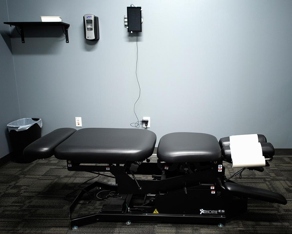 ecw adjustment table Chiropractor Denver